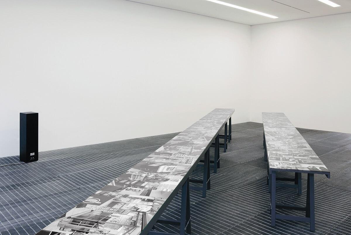 Capital Decor, GfzK, Museum of Contemporary Art, Leipzig, 2010<br /> inkjet print on blueback paper, 50 x 1273 cm, tables, glass<br /> soundwork (20:56 min, voice: Christophe Piette)<br />