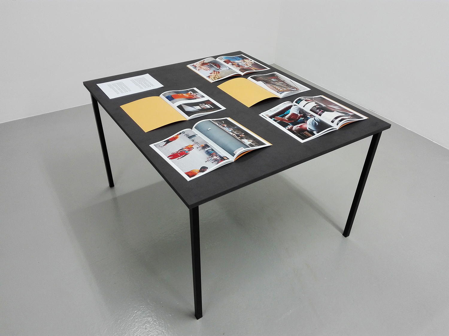 Exhibition view Tender Buttons, curated by Nadja Quante, Anna Voswinckel, Künstlerhaus Bremen 2019<br /> Aanwervingslokaal, 5 magazines and text on a table<br />
